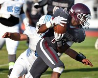 Fort Pierce Westwood junior Tarek Reaves picks up a teammate's fumble Tuesday and runs it in for a touchdown during a spring football game against Rockledge at Lawnwood Stadium in Fort Pierce. (JEREMIAH WILSON/TREASURE COAST NEWSPAPERS)