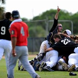 Mike Shabareck (right), catcher for the American Legion Post 358 team of Fort Pierce, holds up his finger stating the team's status after they won the state title during the American Legion State Baseball Tournament at the Indian River State College Baseball Complex on Sunday. The team won 8-4.