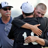 Mike Shabareck (right), catcher for the American Legion Post 358 team of Fort Pierce, hugs hitting coach Bingo Long after the team won the state title during the American Legion State Baseball Tournament at the Indian River State College Baseball Complex on Sunday. 'I coach because of the kids,' said Long. Behind them is coach Pete Wells. The team won 8-4.