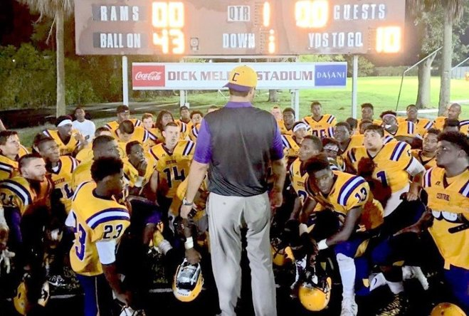 PATRICK BERNADEAU/SPECIAL TO TREASURE COAST NEWSPAPERS First-year Fort Pierce Central High School coach Matt Helmerich talks with his Cobras during Friday night's spring jamboree at Palm Beach Lakes High School.