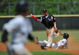 Eric Enrico (center) of Vero Beach Post 39 tries unsuccessfully to complete a double play as Mike Shabareck (left) of Fort Pierce Post 358 beats the throw during the American Legion state tournament at Indian River State College on Saturday.