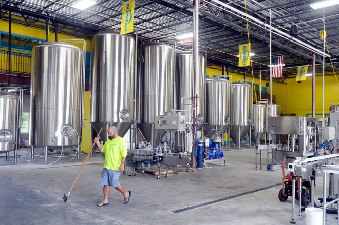 Jose Herrera, co-founder and director of sales and marketing at Islamorada Beer Company, walks through the brewery's new 25,000-square-foot facility at 3200 St. Lucie Blvd. near the Treasure Coast International Airport and Business Park in Fort Pierce. The brewery outgrew it's operation in the Florida Keys and looked for more space, eventually deciding on Fort Pierce. (PATRICK DOVE/TREASURE COAST NEWSPAPERS)