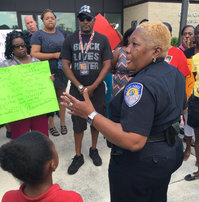 Fort Pierce Police Chief Diane Hobley-Burney speaks to demonstrators at the Fort Pierce Police Department on April 26, 2016, in the wake of the Demarcus Semers killing. (FILE PHOTO)