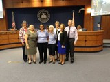 Photo provided:Members of the Pilot Club of Fort Pierce present $1,500 to the St. Lucie County School Board.
